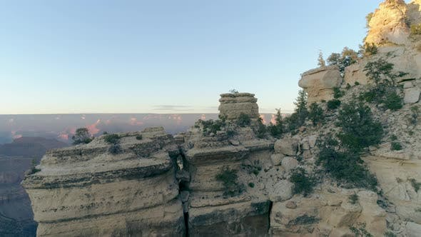 Cover Image for Recognizable Wide Aerial Sliding Shot Across Rocky Terrain of Mountain Canyons Vast
