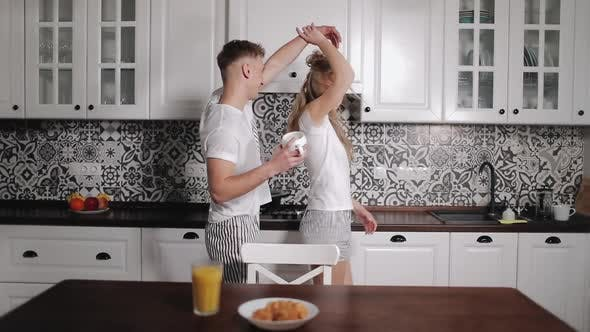 Thumbnail for Young Couple Dancing in Kitchen