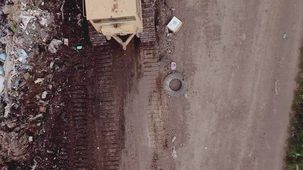 Thumbnail for Bulldozer Shovels Rubbish in One Pile