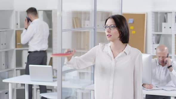Thumbnail for Female Colleague Practicing Ping-Pong in Office