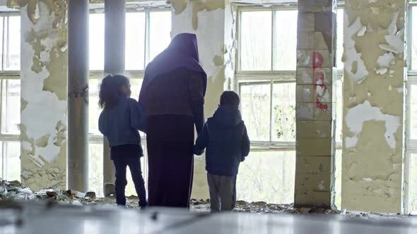 Thumbnail for Female Refugee with Children in Abandoned House