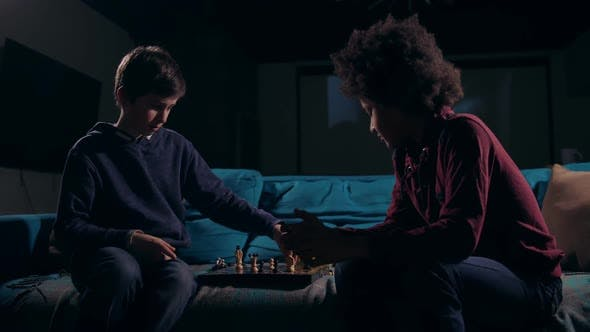 Cover Image for Diverse Teen Chess Players Ending Game at Night