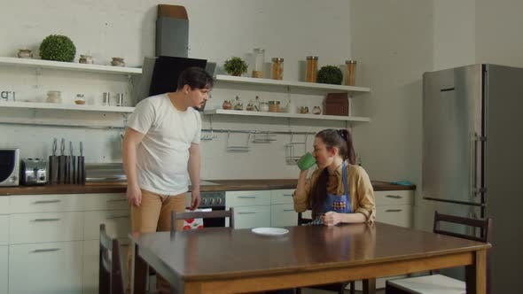 Adult Man and Woman Arguing in Domestic Kitchen