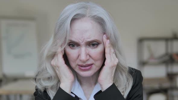 Thumbnail for Senior Businesswoman with Headache