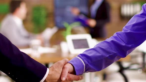 Thumbnail for Close Up of Businessmen Shaking Hands After an Agreement