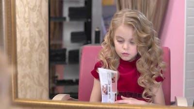 Little Girl Reading Magazine