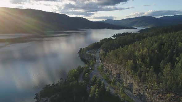 Cover Image for Flying Over Road with Cars and Kroderen Lake Shore in Norway
