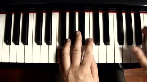Pianist Hands playing a Grand Piano.