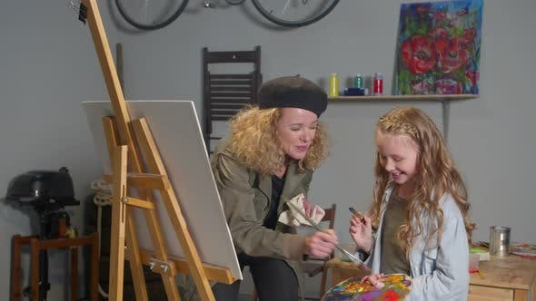 Thumbnail for Happy Girl and Woman Paint a Picture