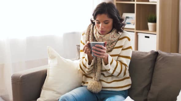 Thumbnail for Sick Young Woman in Scarf Drinking Hot Tea at Home 5