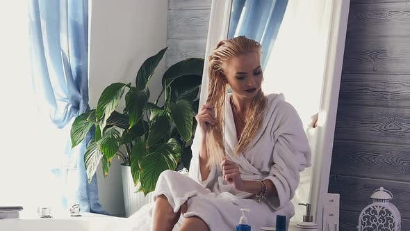 Thumbnail for Girl After Shower Puts Liquid on Hair
