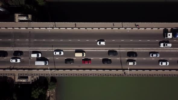 Thumbnail for Drone's Eye View Aerial Top Down View Of Traffic Driving Over A Modern Bridge