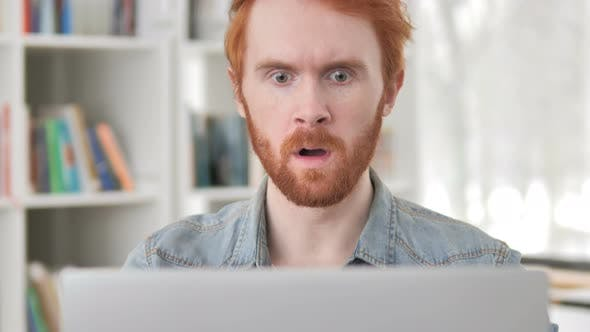 Thumbnail for Shocked Casual Redhead Man Working on Laptop