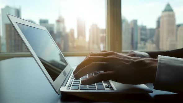 Business Person Working on Laptop Computer Desk