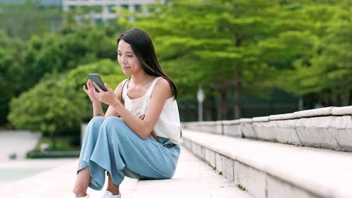 Young woman use of mobile phone in city