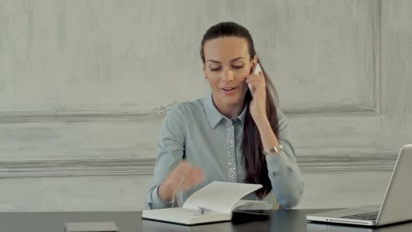 Happy Businesswoman Talking On The Cell Phone In Modern