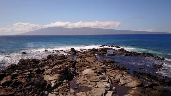 Thumbnail for Waters of Blue Ocean Splashing Against the Stones in Sunny Day on Maui,hawaii