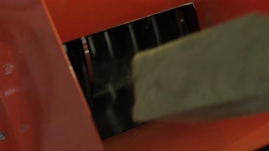 Heat-insulating Panel Is Cut By Shredder.