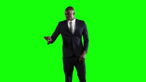 Thumbnail for an African American man in suit in green background
