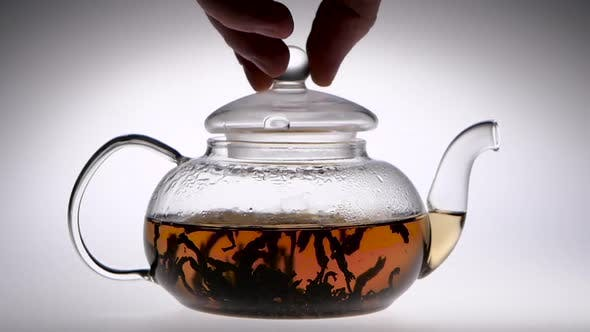 Thumbnail for Transparent Teapot with Tea Close the Lid. Slow Motion, Closeup