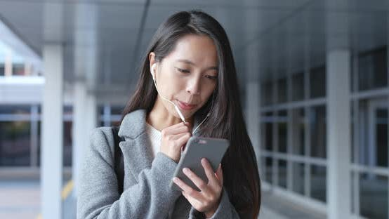Thumbnail for Woman talk to mobile phone on hand free