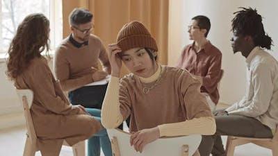 Portrait of Sad Asian Female at Psychologist