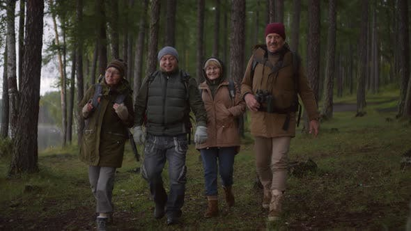 Thumbnail for Cheerful Senior Friends Hiking in Forest