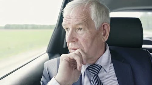 Worrying Politician in Car