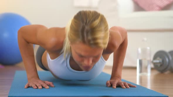 Thumbnail for Healthy blonde woman resting while doing push ups