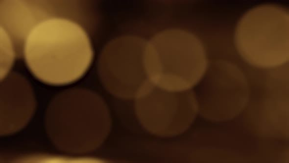 Cover Image for Gold Yellow Bokeh Particles Background