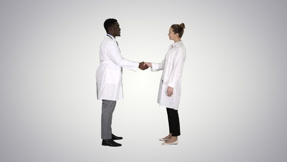 Thumbnail for Nice to Meet You Doctors Meet and Shake Hands on Gradient