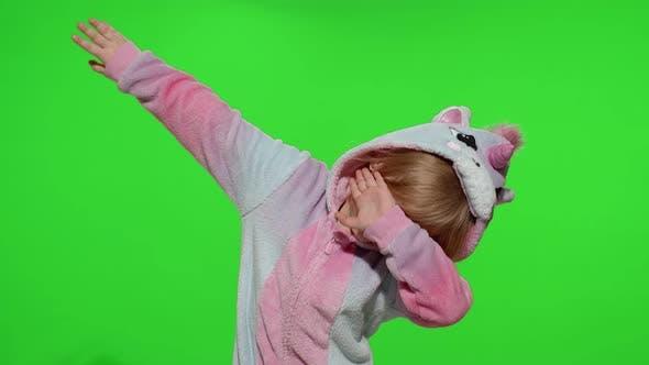 Thumbnail for Little Blonde Child Girl Dancing Celebrating Performing Dab Dance in Unicorn Pajamas Costume