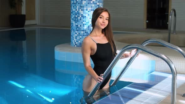 Thumbnail for Sexy young woman in black bathing suit in spa pool staying near poolside