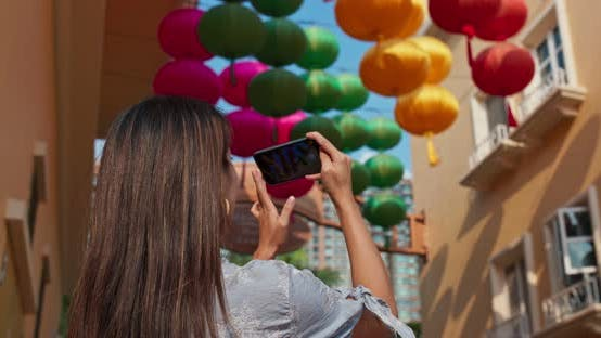 Thumbnail for Woman take photo on cellphone with chinese lantern at outdoor