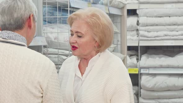 Cover Image for Lovely Senior Lady and Her Husband Choosing Linen for Their Home