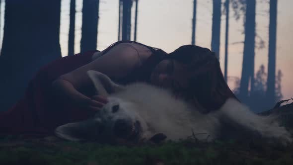Thumbnail for Girl caressing a dog