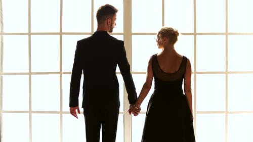 Ballet Couple Holding Hands Back View