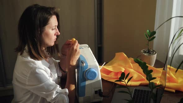 Woman Learning Online Sewing