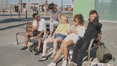 Content Multiethnic Friends on Street Bench