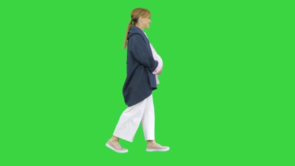 Thumbnail for Happy Pregnant Blonde Lady Walking on a Green Screen, Chroma Key.