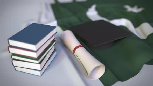Graduation Cap and Diploma on the Flag of Pakistan
