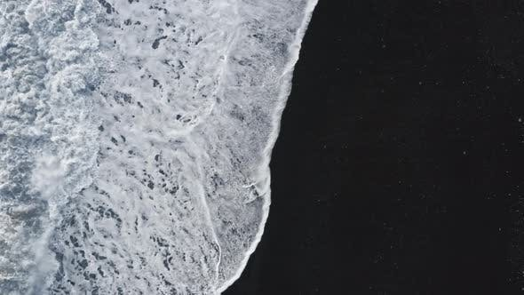 Contrasting Black Sand Beach And White Water