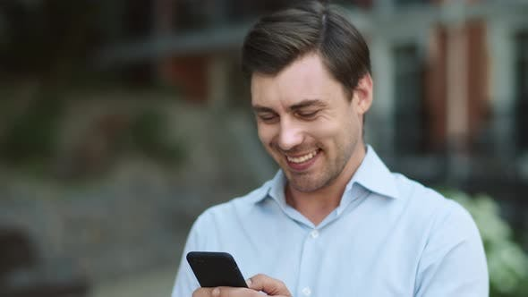 Thumbnail for Closeup Businessman Using Smartphone at Street. Man Typing on Phone Outside