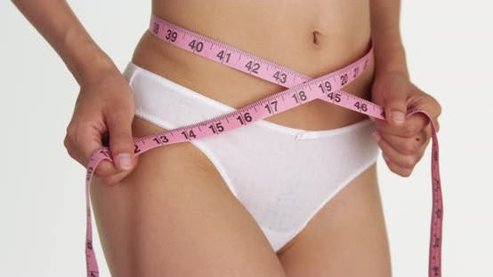 Thumbnail for Fit woman measuring waist