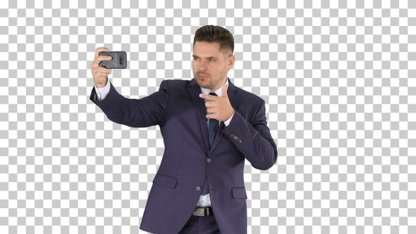 Thumbnail for Handsome man in suit taking a selfie while walking, Alpha Channel