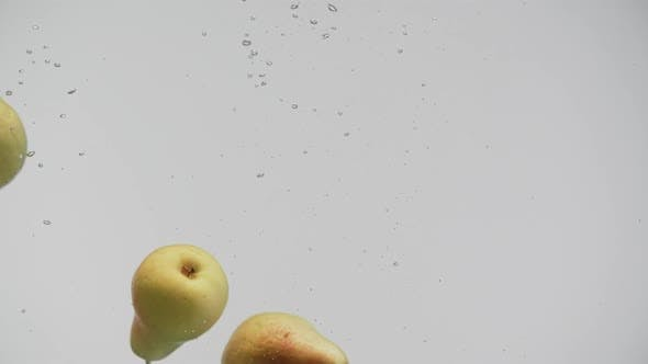 Thumbnail for Ripe Fruits Red and Yellow Pears Under Water with Splash and Air Bubbles White Background