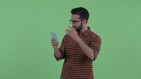 Cover Image for Happy Young Bearded Persian Hipster Man Taking Selfie