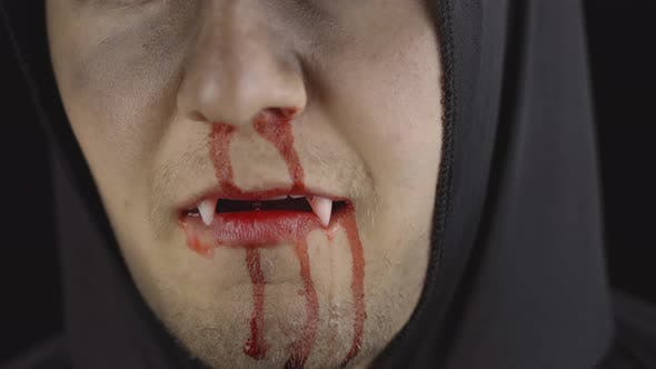 Thumbnail for Man Vampire Halloween Makeup and Costume. Guy with Blood on His Face