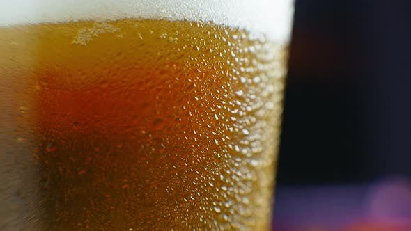 Thumbnail for Macro Shot of a Beer Glass with Cold Beer, Bubbles Rise in the Glass. Slow Motion Beer Bubbles.