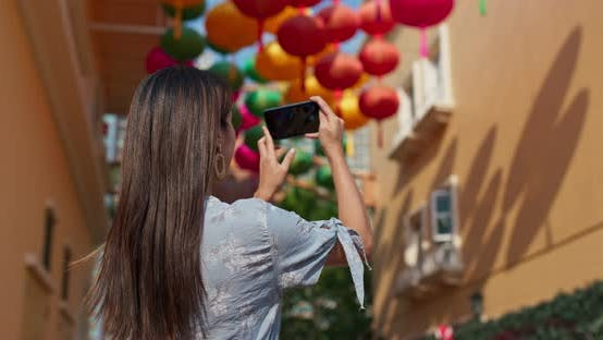 Thumbnail for Woman take photo on mobile with chinese lantern at outdoor